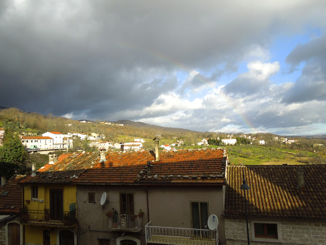 View from our apartment: Rainbow falling on the convent and olive grove in the distance!