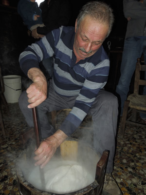 stirring the curd in hot water